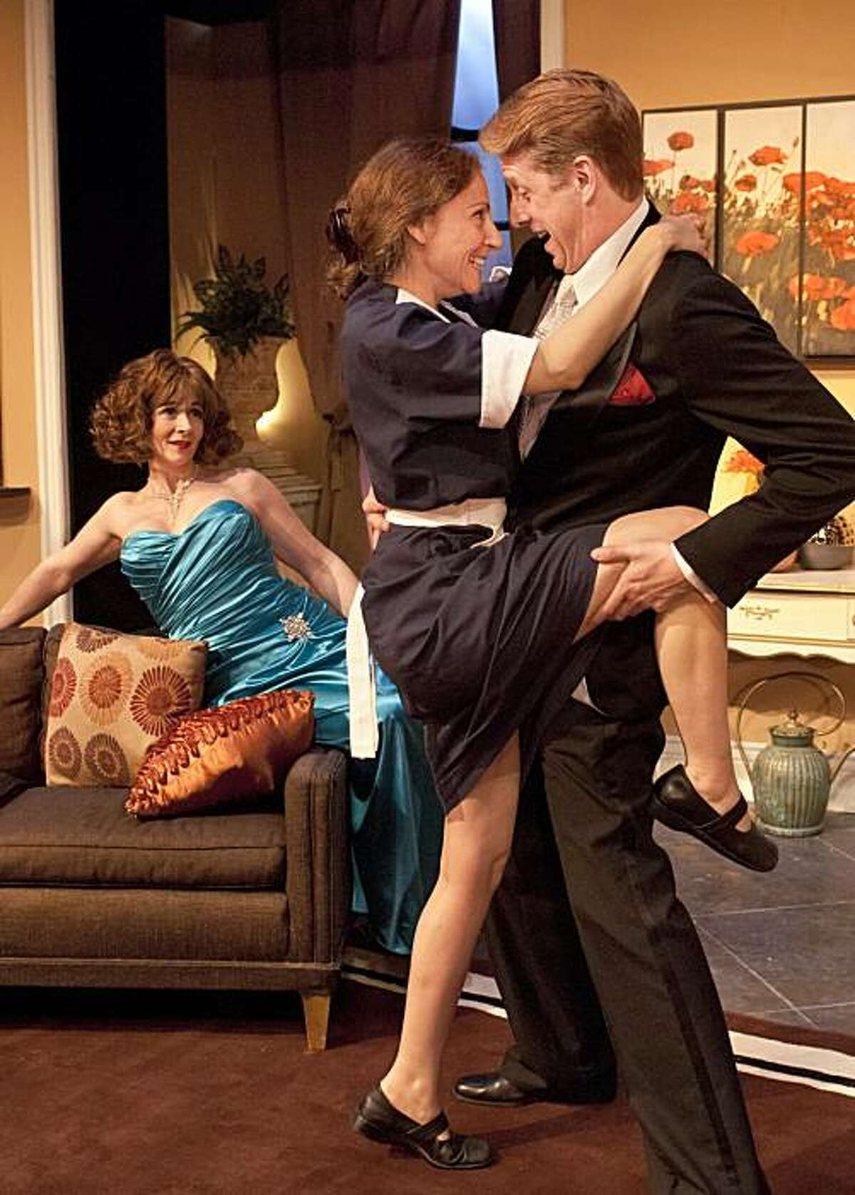 """Tibby (Sarah Shoshana David, left) watches as her maid Myra (Alison Sacha Ross) greets family friend Hank (Patrick Michael Dukeman) in Paul Rudnick's """"Regrets Only"""" at New Conservatory Theater"""