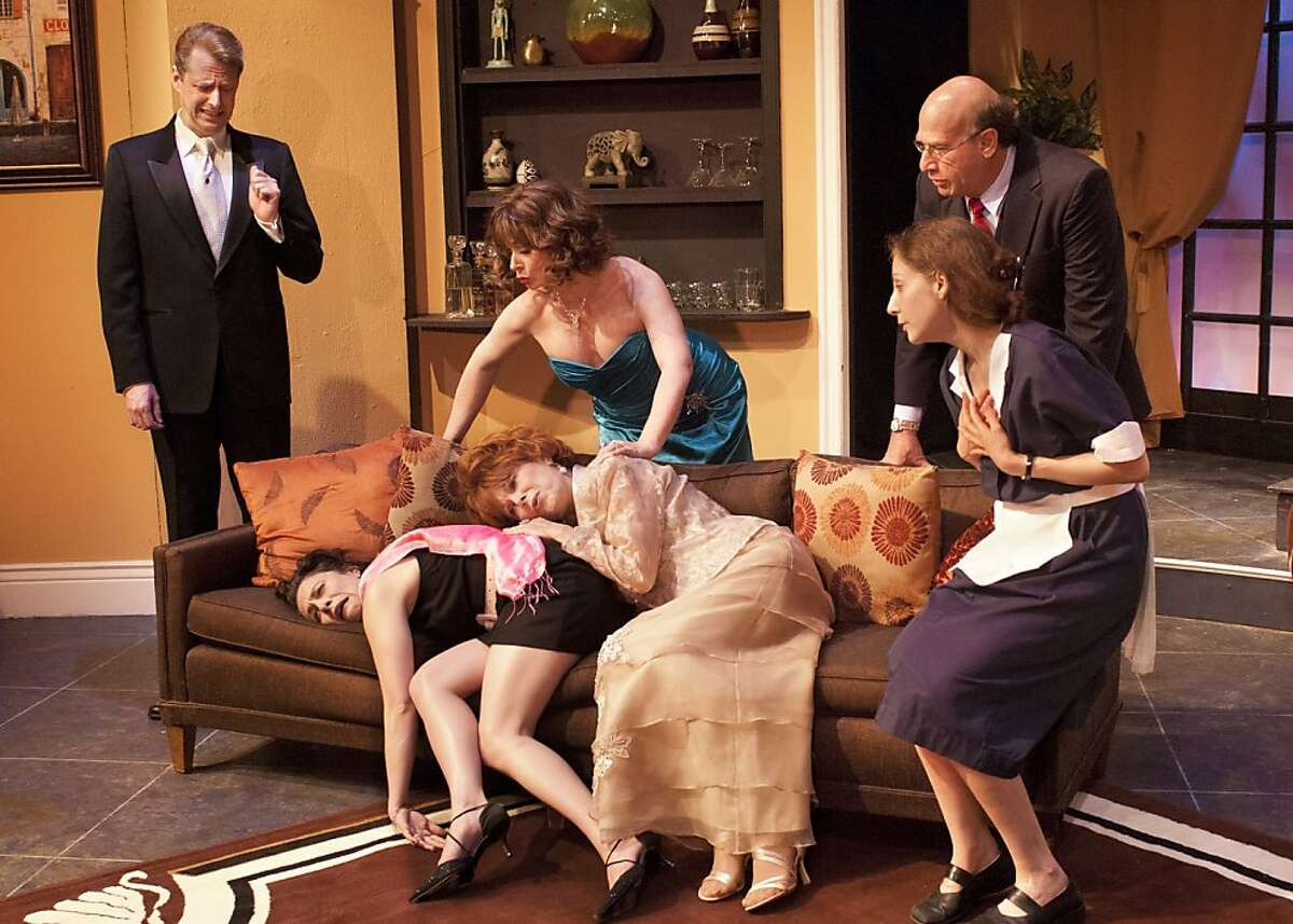 """The McCullough family reacts when Hank (Patrick Michael Dukeman, left) reveals his plan for the wedding (Sarah Shoshana David and Robin Schild behind couch, bride Annamarie MacLeod and Royanne Florence on couch and Alison Sacha Ross, right) in Paul Rudnick's """"Regrets Only"""" at New Conservatory Theater"""