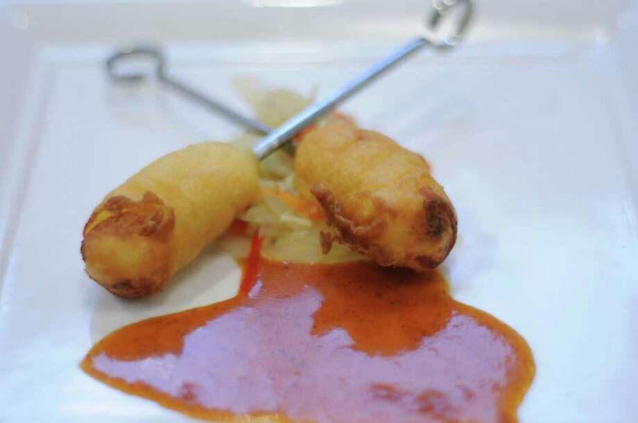 "Two Atlantic king salmon corn dogs made by chefs at Cornell University are seen on a plate during a cooking competition at the Skidmore College dining hall on Tuesday, Jan. 10, 2012 in Saratoga Springs, NY.  The college was hosting 10 culinary teams from regional colleges for a two-day conference titled ""Healthy Foods, Sustainable Choices.""   (Paul Buckowski / Times Union) Photo: Paul Buckowski"