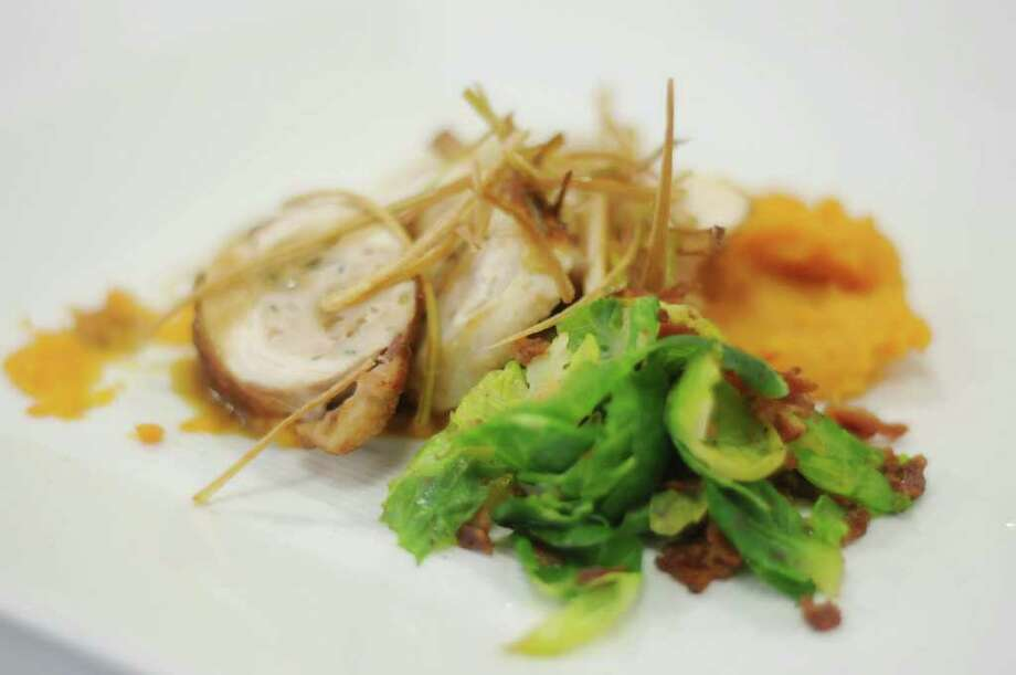 """Seared chicken roulade made by chefs from RPI is seen on a plate  during a cooking competition at the Skidmore College dining hall on Tuesday, Jan. 10, 2012 in Saratoga Springs, NY.  The college was hosting 10 culinary teams from regional colleges for a two-day conference titled """"Healthy Foods, Sustainable Choices.""""   (Paul Buckowski / Times Union) Photo: Paul Buckowski"""