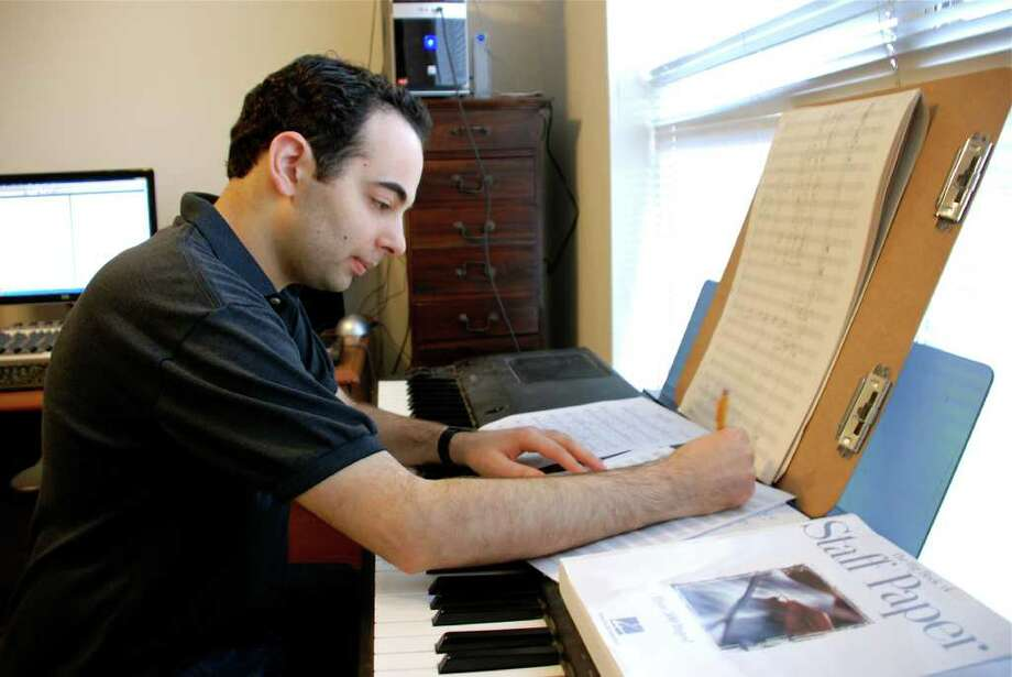 LINDSAY PEYTON: FOR THE CHRONICLE TAKING NOTE: Composer and lyricist Aaron Alon is now an assistant professor at Lone Star College- CyFair, where next semester he will teach students the basics of songwriting   lyric writing, form, melody and harmony. Photo: Lindsay Peyton