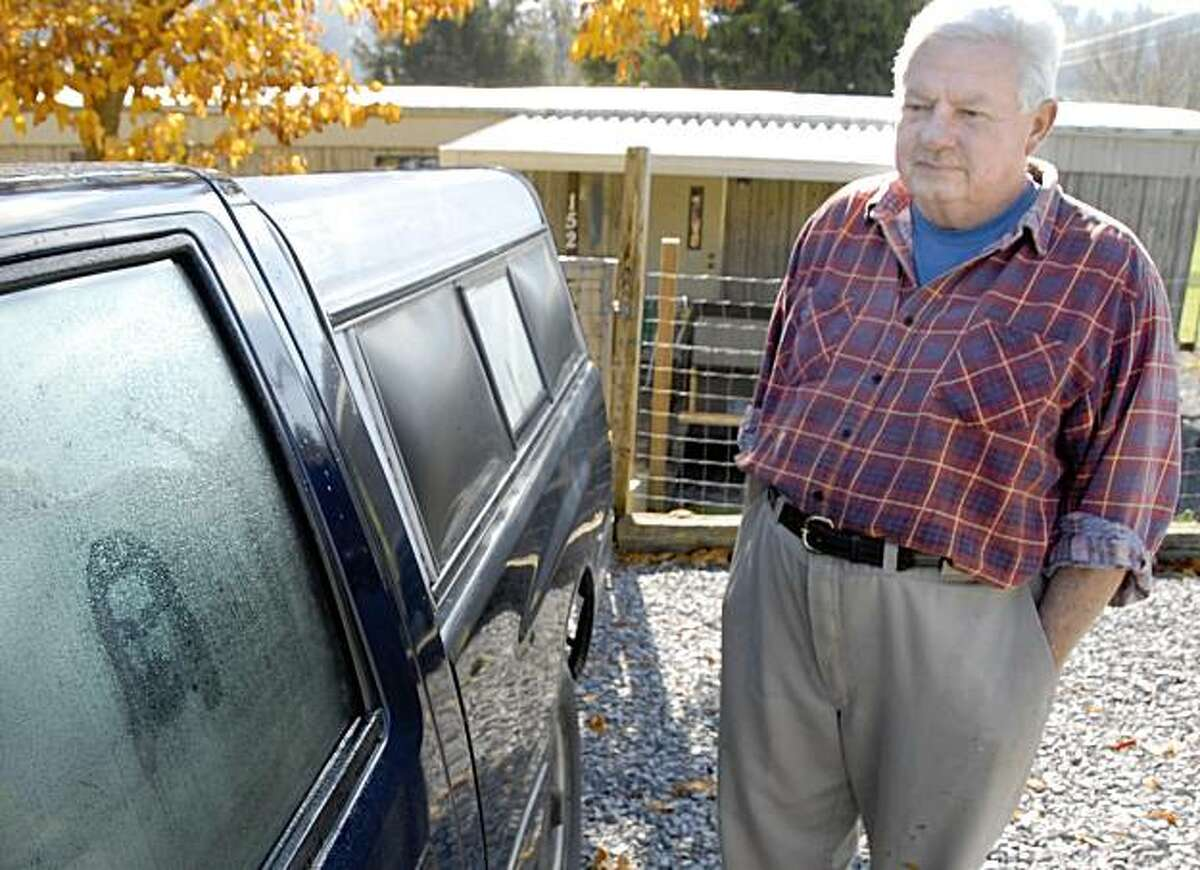 Jim Stevens stands next to his truck with the image of Jesus on the window in Jonesborough, Tenn., Monday, Nov. 2, 2009. Stevens says he's not particularly religious and is clueless about why the image resembling Jesus Christ keeps appearing on his pickup.