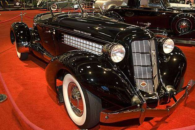"1935 Auburn 851 Speedster. Auburn automobiles were built in Auburn Indiana from 18900 to 1936. Purchased by E.L. Cord in 1924. E.L. Cord partnered with Dusenberg in 1926. Automotive designers to credit Alan Leamy and Gordon Buehrig. Despite good value, poor sales caused closure October 1936. This example is a ""dual ratio"" model with a Columbia rear differential coupled to a supercharged straight eight engine of 150 HP. Total production for 1935 and 1936 was a mere 7160. Price when new approximately $3,000. Photo: Stephen Finerty"