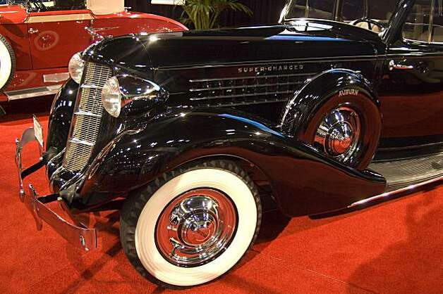 "1935 Auburn 851 Supercharged Coupe. The end for Auburn was near when this exceptionally rare Sport Coupe, one of only 1545 in 1935 and 1936 was manufactured. With plenty of glass and good vision, its lucky 2 passengers could travel in high style at fast and comfortable speeds. This example also features a rare Auburn-Crosley radio and a heater. Power comes from a Lycoming straight eight supercharged engine of 150 HP through a 3-speed gear box and 2 speed ""dual ratio"" rear differential. Photo: Stephen Finerty"