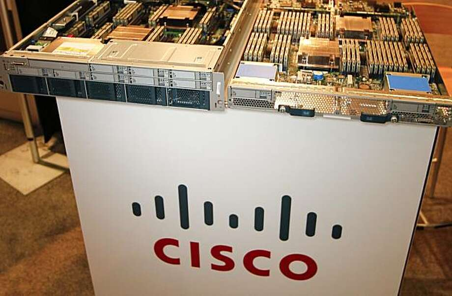 Cisco Systems Inc.'s Unified Computing Systems, B250 Blade, right, and C250 Rack Mounted units sit on display at the Microsoft Tech-Ed North America Conference at the Ernest N. Morial Convention Center in New Orleans, Louisiana, U.S., on Thursday, June 10, 2010. Microsoft Corp., the world's biggest software maker, raised $1.15 billion of interest-free financing from its first sale of convertible bonds. Photographer: Derick E. Hingle/Bloomberg Photo: Derick E. Hingle, Bloomberg