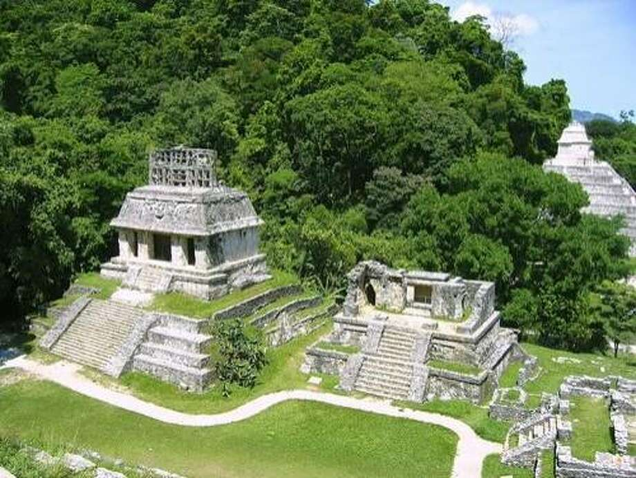 Nestled in a damp rainforest near Chiapas' northern border, Palenque isn't the biggest of Mexico's Maya ruins, but surely one of the most captivating. Photo: Tonobalaguerf, Shutterstock