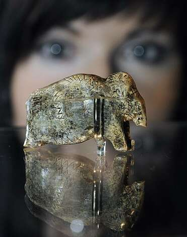 A woman views what is claimed to be the oldest known art work of mankind, at the Neanderthal Museum in Mettmann, western Germany, Friday, Nov. 19, 2010. The mammoth ivory carving of prehistoric man is 35,000 years old, and was found in southern Germany. Anew mammoth exhibition shows the giants of the ice age in the famous valley, where the Neanderthal Man was found. Photo: Martin Meissner, AP