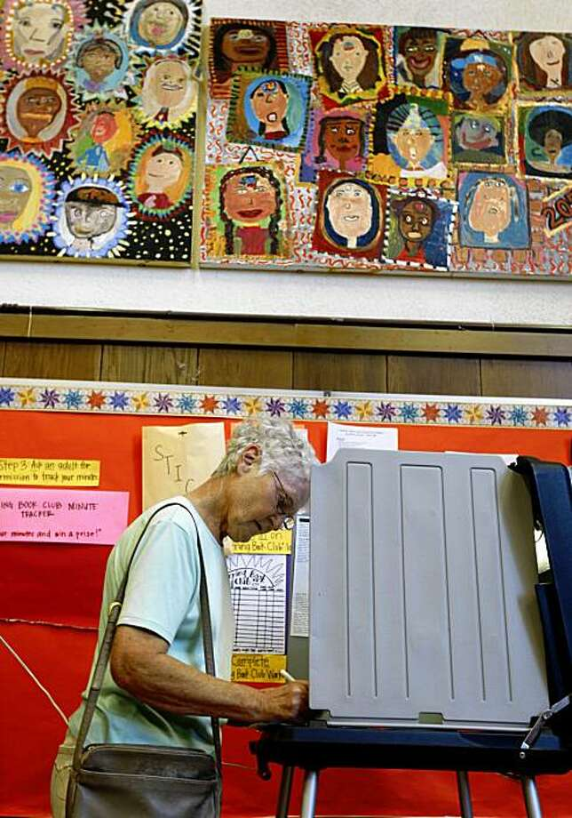 Pat Holleran marks her ballot at a polling place at Harvey Milk Elementary School in San Francisco. Photo: Paul Chinn, The Chronicle