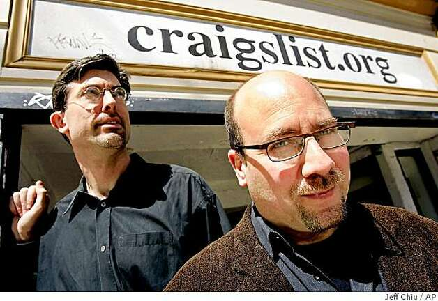 In this April 14, 2005 file photo, Craigslist.org CEO Jim Buckmaster, left, and founder Craig Newmark, center, are photographed outside of their office in San Francisco. Photo: Jeff Chiu, AP