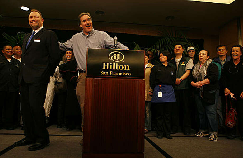 Mike Casey, center, president of Local 2, celebrates the announcement of a tentative labor deal with Michael Dunne, left, Hilton General Manager. Members of the Unite Here Local 2 union hold a press conference at the Hilton Hotel, 333 O'Farrell Street, to announce the details of a tentative agreement between the union and Hilton Hotel chain, ending an 18-month labor dispute. Photo: Anna Vignet, The Chronicle