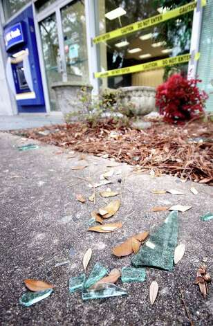 Pieces of glass litter the sidewalk outside RBC Bank in Shelby, N.C. on Mondayafter a deer entered the bank on the Sumter Street side of the building and left near the entrance of the lobby. Photo: AP