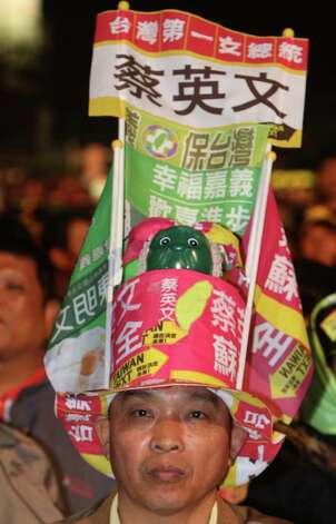 A supporter of Democratic Progressive Party's Presidential candidate Tsai Ing-wen wears slogans during a presidential campaign rally in Taichung, Taiwan, on Tuesday. Taiwan will hold its presidential election on Saturday. Photo: AP