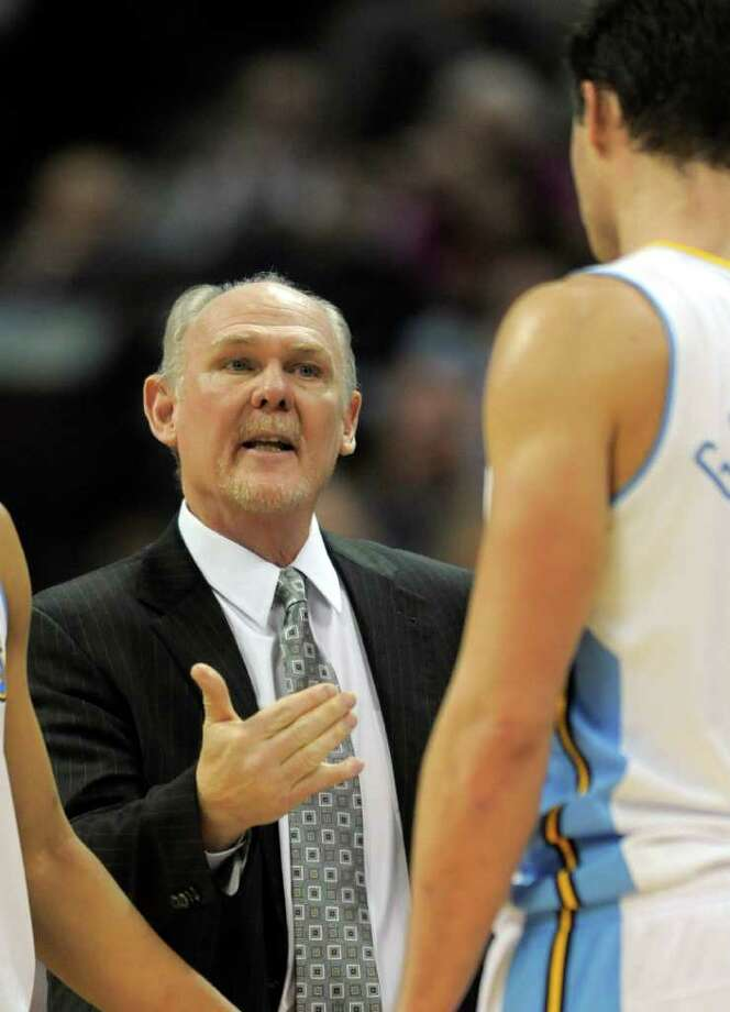 "Coach George Karl (left) says his Nuggets, like the Spurs, are built around ""character, low-maintenance guys."" Photo: AP"