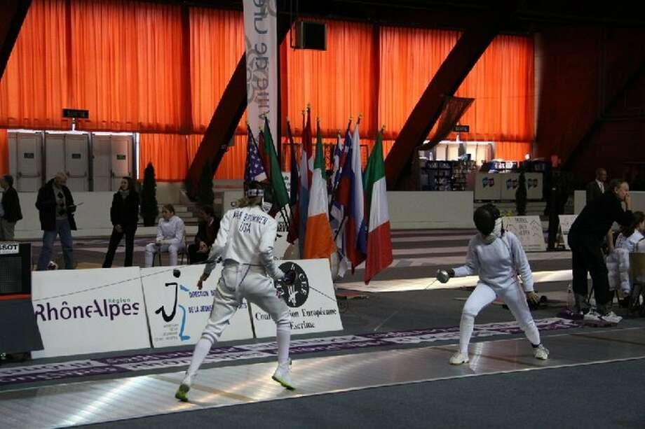 Anna Van Brummen, left, fencing Photo: Courtesy Of Gayle Van Brummen.