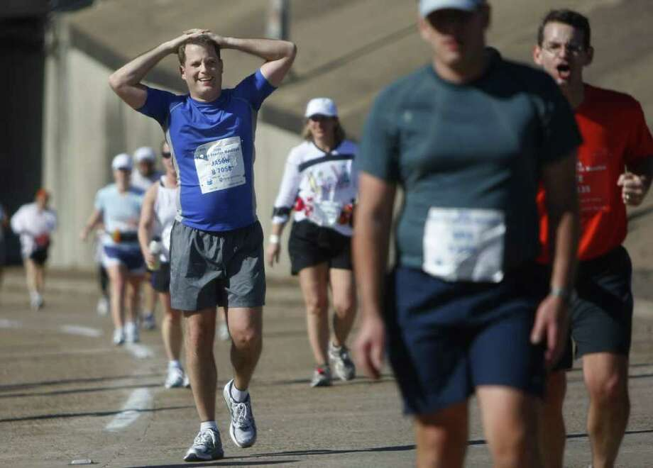 Jason Gage, 35, of Cypress, catches his breath at the 24-mile marker along Allen Parkway during the 2008 Chevron Houston Marathon. Photo: Mayra Beltran / Houston Chronicle