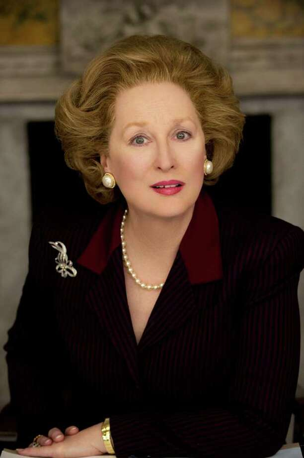 Meryl Streep, left, stars as Margaret Thatcher, the prime minister of the United Kingdom from 1979 to 1990, in The Iron Lady. At right, is Thatcher in 1986. Photo: ALEX BAILEY / WEINSTEIN COMPANY