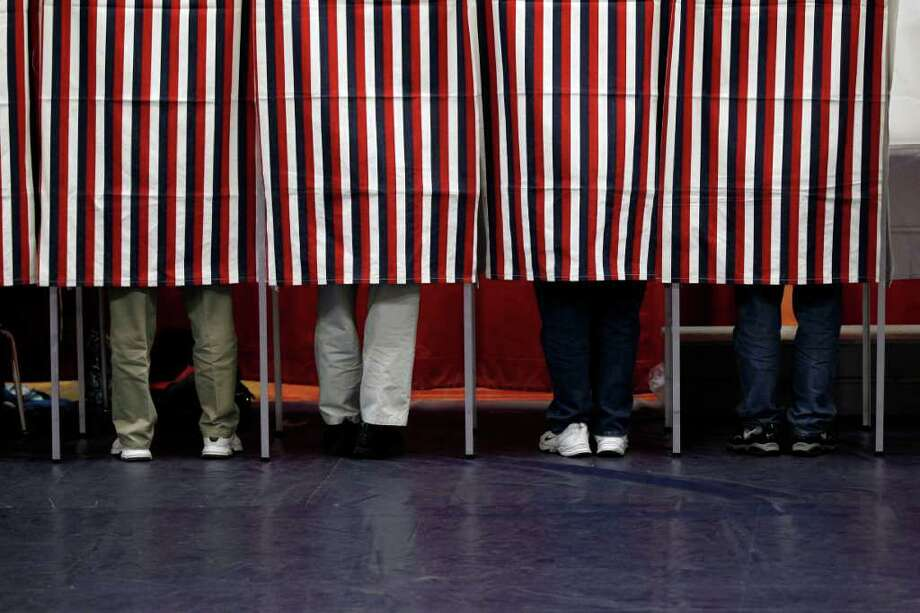 Voters mark their ballots on Tuesday, Jan. 10, 2012, during voting in the first-in-the-nation presidential primary, at Memorial High School in Manchester, N.H. Photo: Matt Rourke, Associated Press / AP