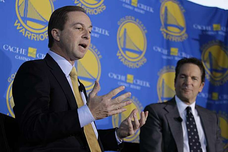 Golden State Warriors new owners Joe Lacob, left, gestures as Peter Guber, right, looks on during their introduction at a luncheon in San Francisco, Monday, Nov. 15, 2010. The sale of the Golden State Warriors NBA basketball team was completed last week to an ownership group headed by Lacob and Guber. Lacob will serve as co-executive chairman, CEO and governor and Guber will servce as co-executive chairman and alternate governor. (AP Photo/Eric Risberg) Photo: Eric Risberg, ASSOCIATED PRESS