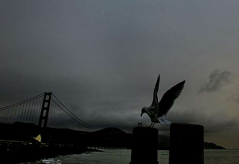 Rain - 6:22 p..m. - San Francisco.  I wandered down to Crissy Field looking for a late afternoon weather photo as a small rain storm made it's way into San Francisco Bay.   Camera settings: Canon 1D MkIV, ISO 400, 1/250, f11, 20mm lens. Photo: Michael Macor, The Chronicle