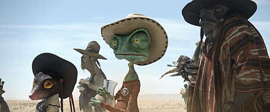 Left to right: Priscilla (Abigail Breslin), Rango (Johnny Depp), and Wounded Bird (Gil Birmingham) in RANGO, from Paramount Pictures and Nickelodeon Movies. Photo: Paramount Pictures