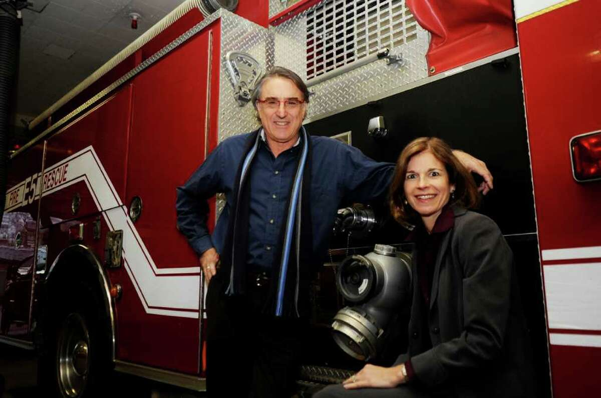 Peter Lobel, a native Zimbabwe, and his wife, Diane, pose at a fire truck at the Sound Beach Volunteer fire Department. The Lobels recently donated two fire trucks to the city of Harare in Zimbabwe.
