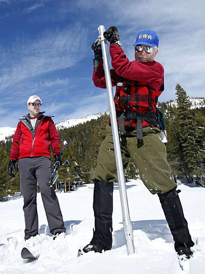 Frank Gehrke, right,  chief of snow surveys for the Department of Water Resources, removes the snowpack survey tube out of the snow as Curtis Taras, of the Central Valley Flood Protection Board looks on during the snow survey at Echo Summit, Calif.,Echo Summit, Calif., Tuesday, March 1, 2011. The survey showed the snow pack to to be 89 inches deep, with a water content of 31.7 inches which is about 128 percent of normal at this location for this time of the year. Photo: Rich Pedroncelli, AP