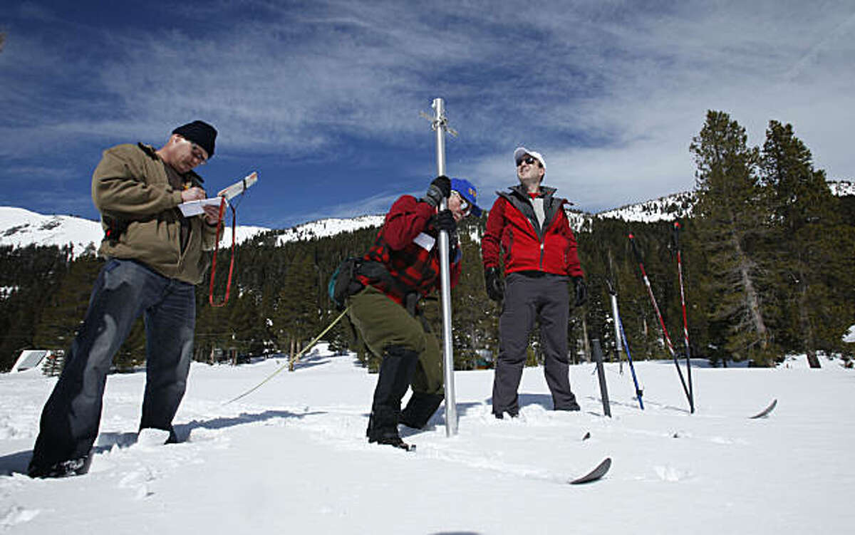 Frank Gehrke, chief of snow surveys for the Department of Water Resources, center, removes the snowpack survey tube from the snow as DWR's Jon Ericson, left, records the depth and Curtis Taras, of the Central Valley Flood Protection Board looks on duringthe snow survey at Echo Summit, Calif.,Echo Summit, Calif., Tuesday, March. 1, 2011. The survey showed the snow pack to to be 89 inches deep, with a water content of 31.7 inches which is about 128 percent of normal at this location for this time of the year.