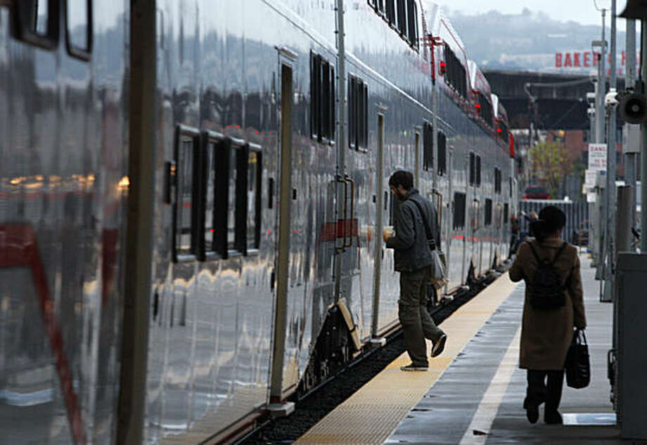 A passenger boards a southbound Baby Bullet train at the Caltrain station in San Francisco, Calif., on Wednesday, Dec. 22, 2010. Caltrain will start operating the Baby Bullet express service on weekends beginning Jan. 1 for a trial period. Photo: Paul Chinn, The Chronicle
