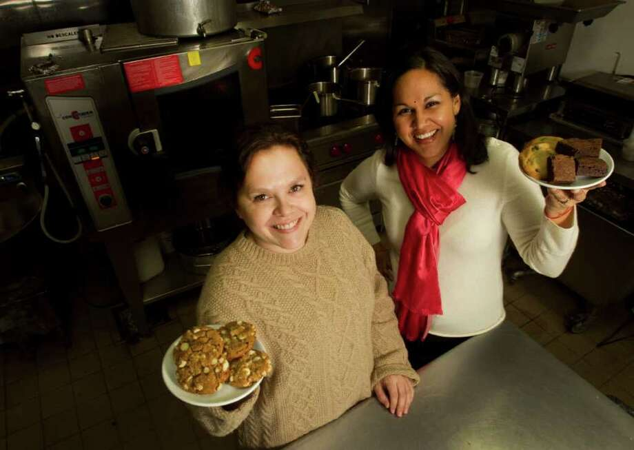 Pastry chef Rebecca Masson, left, and food blogger Nishta Mehra pose for a portrait in the kitchen at Revival  Market in the Heights. Photo: Brett Coomer / © 2012 Houston Chronicle