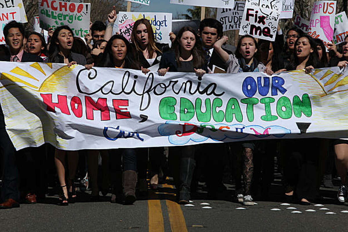 Students walking down 13th at L streets toward the state capitol in Sacramento, Calif., on Monday, February 28, 2011. UC and CSU are each expected to lose at least $500 million in state funding, while the community colleges are looking at a minimum cut of $400 million.
