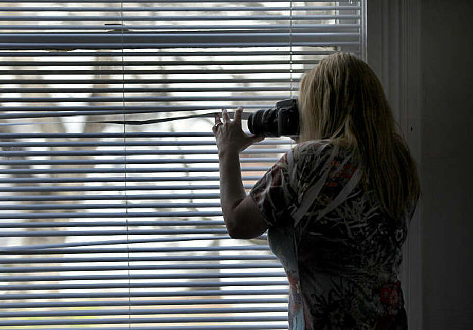A member of the Ohio Street Watch Dogs group uses a camera to photograph women lingering on the street that may be prostitutes. Neighborhood groups around Vallejo, Calif., have sprung up in order to fight prostitution, crime and quality of life issues as the town struggles to become solvent again. Photo: Brant Ward, The Chronicle