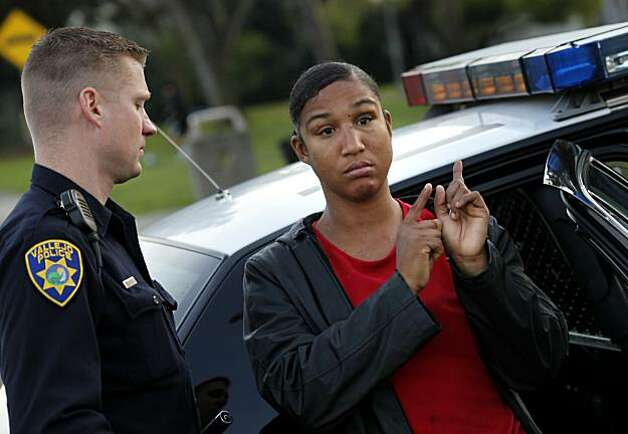 Chandra Brown (right) talks with Vallejo police officer Shane Bower after being detained on the street.  Brown has been on probation  following a prostitution conviction in 2010.  The citizens of Vallejo, Calif., have formed watch groups to combat an increase in prostitution in their neighborhoods since the city declared bankruptcy and the police force was cut. Photo: Brant Ward, The Chronicle