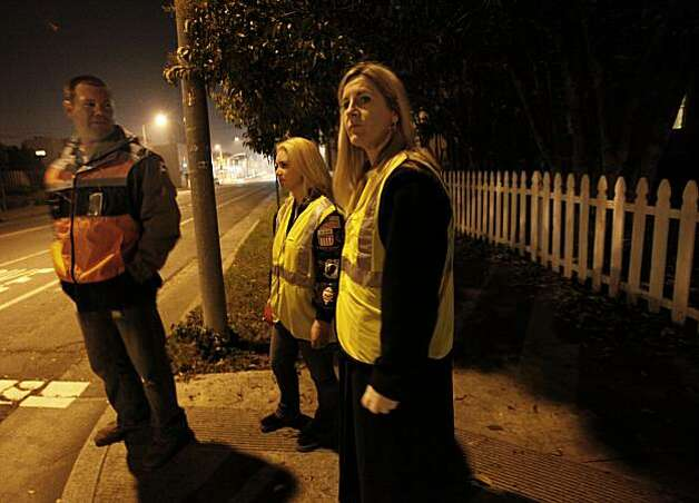 Members of the Kentucky Street Watch Owls neighborhood group walk the area around their home looking for prostitutes. The citizens of Vallejo, Calif., have formed watch groups to combat an increase in prostitution in their neighborhoods since the city declared bankruptcy and the police force was cut. Photo: Brant Ward, The Chronicle