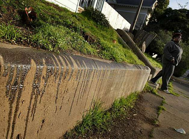 Neighbors on Marin Street in Vallejo have taken to pouring grease on their low retaining walls to keep the prostitutes from lingering. The citizens of Vallejo, Calif., have formed watch groups to combat an increase in prostitution in their neighborhoods since the city declared bankruptcy and the police force was cut. Photo: Brant Ward, The Chronicle