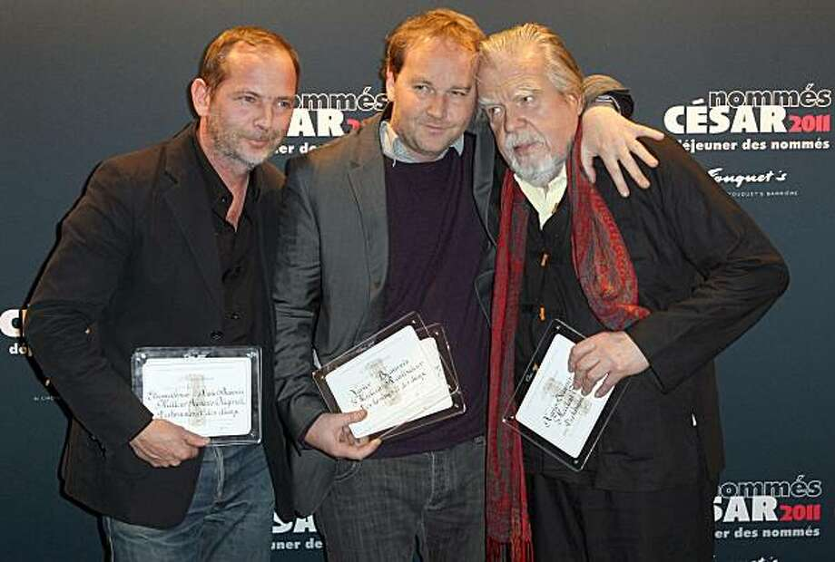 "From L to R, Etienne Comar French film awards Cesars nominee for best original script, Xavier Beauvois nominee for best director and film and Michael Lonsdale nominee for best supporting actor, for their feature ""Des Hommes et des Dieux"" (Of Gods and Men)pose at the Cesars 2011 nominated breakfast, on February 5, 2011 at the Fouquet's in Paris. Photo: Thomas Samson, AFP/Getty Images"