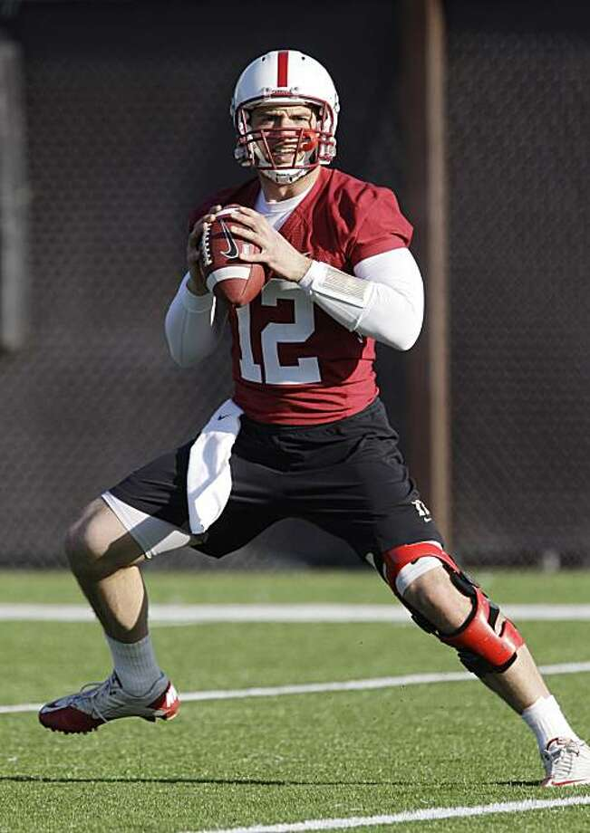 This photo made Feb. 23, 2011, shows Stanford quarterback Andrew Luck painges during an NCAA college football practice on the Stanford University campus in Stanford, Calif.  Luck knows there will be a ton of pressure and pageantry that will follow him next fall as the presumptive Heisman Trophy favorite. He still has no regrets about returning to the Cardinal or turning down being the likely No. 1 pick in the NFL draft this year. Photo: Paul Sakuma, AP