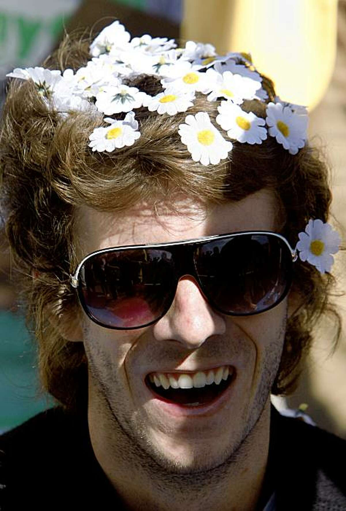 Kyle Shafer took part in a game to see who could have the most flowers in one's hair at once at the Treasure Island Music Festival on Saturday.
