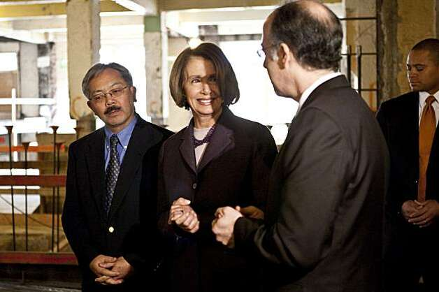 San Francisco Mayor Ed Lee and Democratic Minority Leader Nancy Pelosi tour the Tenderloin YMCA housing development project with Donald Falk, the Executive Director of the Tenderloin Neighborhood Development Corporation, (left to right) at the construction site in San Francisco, Calif., on Friday, January 28, 2011.  The project received 54 million dollars in Recovery Act funding. Photo: Laura Morton, Special To The Chronicle