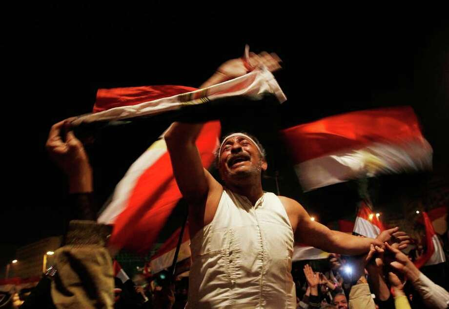 Feb. 10, 2011 | An anti-government protester reacts before Egyptian President Hosni Mubarak was to make a statement in Cairo, Egypt. Egyptian President Hosni Mubarak made a statement in which he refused to step down, defying expectations that he was preparing to resign. Photo: Chris Hondros, Getty / 2011 Getty Images