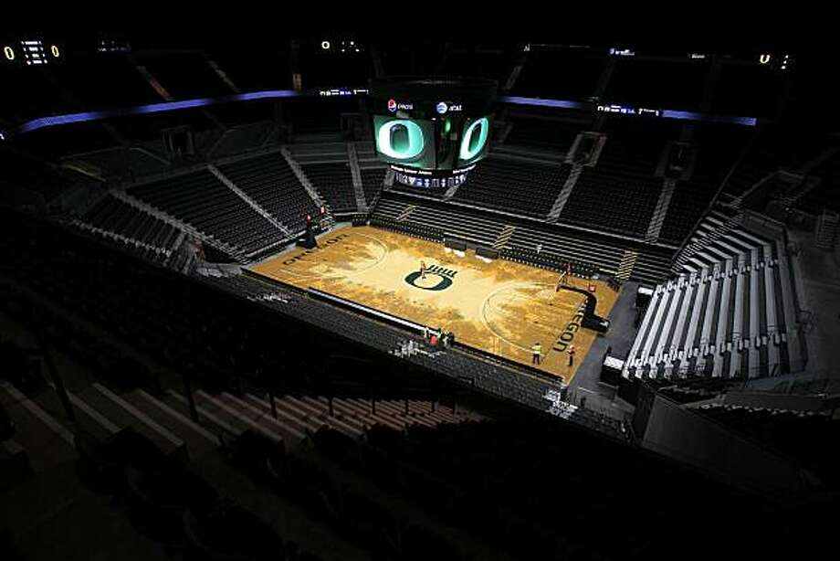 The basketball floor of Matthew Knight Arena at the University of Oregon. The UO men's basketball team plays its first game in the arena on Thursday, Jan. 13 against USC. This photo made Dec. 16, 2010. (AP PHOTO/Kevin Clark/The Register-Guard) Photo: Kevin Clark, AP