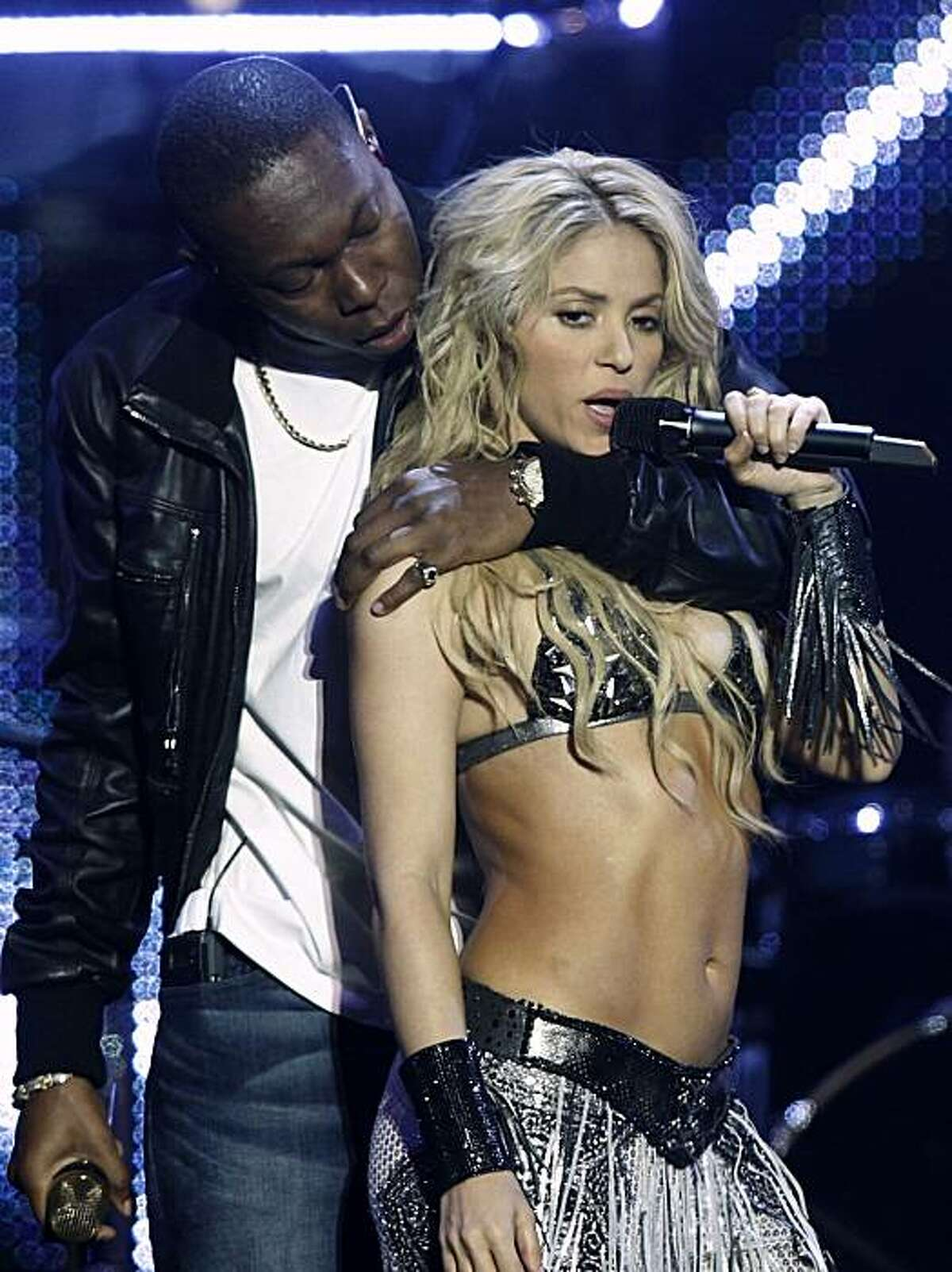 Shakira, right, and Dizzee Rascal perform at the MTV European Music Awards 2010, in Madrid, Sunday, Nov. 7, 2010.