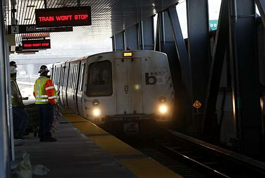 A BART train passes through through BART's new 44th station set to open Feb. 18 in Dublin, Calif., on Friday, February 11, 2011. Construction crews were putting the finishing touches on the station. Photo: Thomas Levinson, The Chronicle