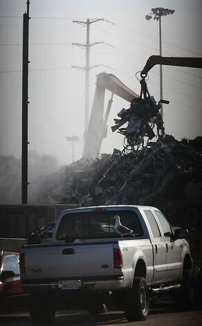 Piles of metal being transferred at Sims Metal Management located at the port of Redwood City, Calif., on Tuesday January 10, 2012.  The south bay facility is home to one of the largest metal shredders in the bay area. Photo: Liz Hafalia, The Chronicle