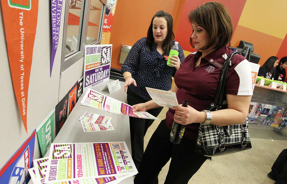 GenTX community events manager Ariane Etemadi (left) shows volunteer Veronica Blanco, Texas A&M regional financial aid advisor, some literature for the upcoming Student Aid Saturdays at Café College on Tuesday, Jan. 10, 2012. A pep rally was held for volunteers of Student Aid Saturdays - an initiative started by SA2020. Volunteers on each Saturday starting on Jan. 28 will help students with completing the state and federal student aid forms and scholarship applications. The program will have over 30 sites with 125 volunteers to help students prepare for higher education. Kin Man Hui/kmhui@express-news.net Photo: KIN MAN HUI, SAN ANTONIO EXPRESS-NEWS / SAN ANTONIO EXPRESS-NEWS