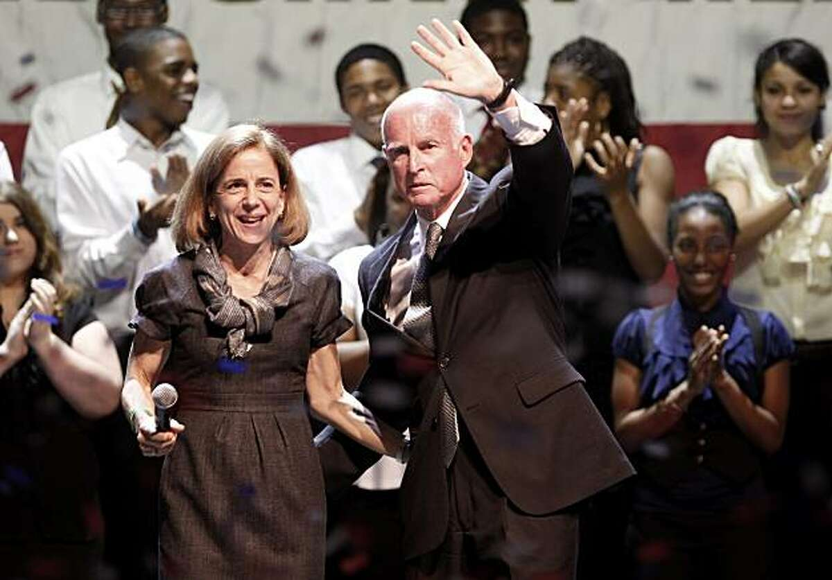 With confetti falling Jerry Brown and his wife Anne Gust waved to supporters. Governor-elect Jerry Brown addressed supporters at the Fox Theatre in downtown Oakland, Calif. Tuesday November 2, 2010.