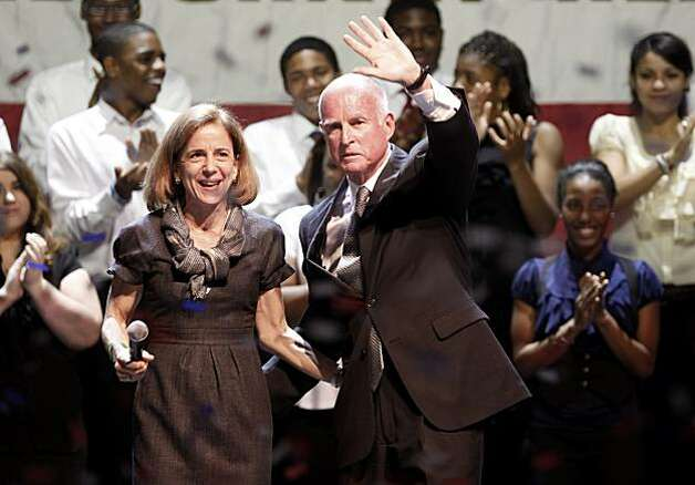 With confetti falling Jerry Brown and his wife Anne Gust waved to supporters. Governor-elect Jerry Brown addressed supporters at the Fox Theatre in downtown Oakland, Calif. Tuesday November 2, 2010. Photo: Brant Ward, The Chronicle