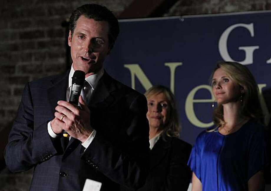Mayor Gavin Newsom, Democratic candidate for lieutenant governor, thanks his supporters at an election night rally while his wife Jennifer (right) looks on in San Francisco, Calif., on Tuesday, Nov. 2, 2010. Photo: Paul Chinn, The Chronicle