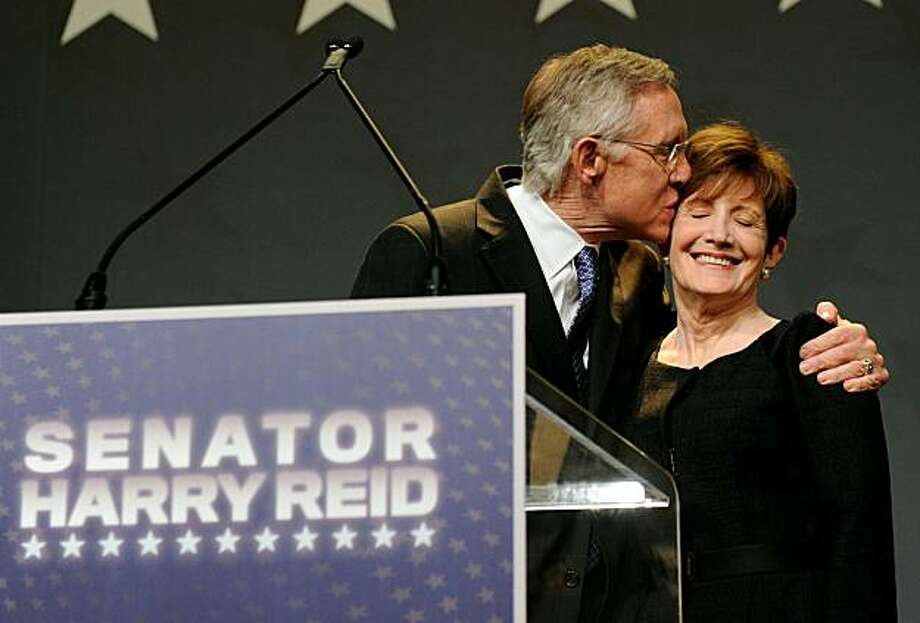 LAS VEGAS - NOVEMBER 02:  U.S. Senate Majority Leader Harry Reid (D-NV) (L) kisses his wife Landra Reid as he gives his acceptance speech after defeating Republican challenger Sharron Angle at the Nevada State Democratic Party's election results party atthe Aria Resort & Casino at CityCenter November 2, 2010 in Las Vegas, Nevada. In one of the nation's most closely watched races, Reid retained his seat for a fifth term against Angle, a Tea Party favorite. Photo: Ethan Miller, Getty Images