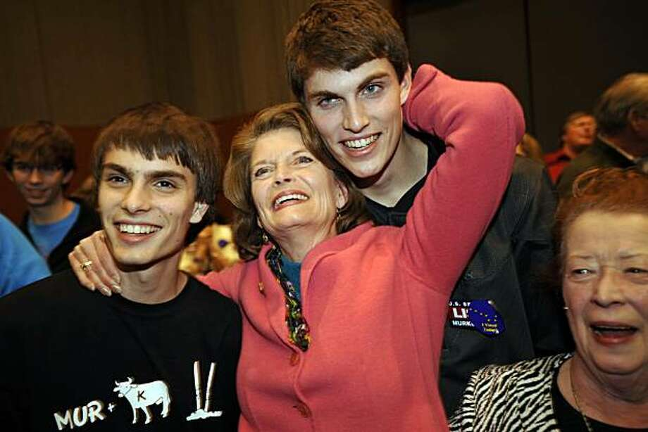Lisa Murkowski, center, greets supporters and cheers early returns at her Election Night party at the Dena'ina Convention Center, November 2, 2010. Also pictured at left is son Matt, son Nic is behind her and friend Hope Nelson is at right. (Marc Lester/Anchorage Daily News/MCT) Photo: Marc Lester, MCT
