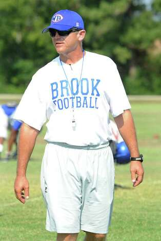 West Brook head football coach Craig Stump observes his players at the start of Tuesday's workout.  August 23, 2011.  Valentino Mauricio/The Enterprise Photo: Valentino Mauricio
